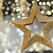 Golden metallic star shiny Christmas decoration — Stock Photo