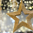 Stock Photo: Golden metallic star shiny Christmas decoration