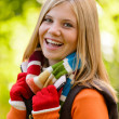 Stock Photo: Autumn happy girl smiling teenager colorful scarf