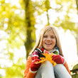 Happy blonde girl teen sitting forest fall — Stock Photo