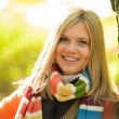 Smiling teenager blonde girl woods tree autumn — Stock Photo