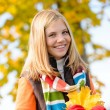 Smiling blonde teen girl autumn forest leaves — Stock Photo