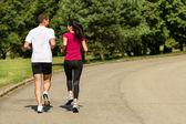Arka görüş-in çift jogging — Stok fotoğraf
