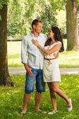 Cuddling boyfriend and girlfriend in park — Stock Photo