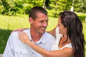 Portrait of young Caucasian couple outdoors — Stock Photo