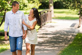Cheerful Caucasian couple walking outdoors — Stock Photo
