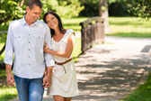 Couple walking in park hand in hand — Stock Photo
