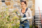Happy woman clipping bush garden hobby clippers — Stock Photo