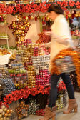 Blurry woman buyer shopping Christmas decorations — Stock Photo