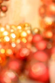 Christmas bulbs glittering background red and gold — Stockfoto