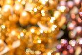 Rozmazané třpytivé zlaté vánoční pozadí — Stock fotografie