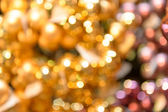 圣诞背景模糊黄金闪闪发光 — 图库照片