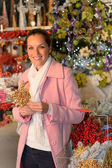 Smiling woman shopping Xmas decorations in shop — Stock Photo
