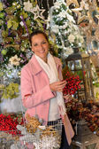 Cheerful woman shopping Christmas decorations — Stok fotoğraf