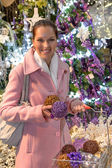 Woman in festive mood buying Christmas ornaments — Stock Photo