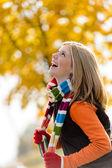 Carefree laughing young blonde girl autumn forest — Stock Photo