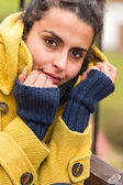 Young woman portrait in yellow coat fall — Stock Photo