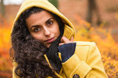 Cozy fall background woman hood feel chilly — Stock Photo
