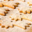 Baking christmas cookies comet star powdered sugar — Stock Photo #31601869