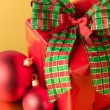 Stock Photo: Red Christmas present and decoration gift card