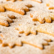 Stock Photo: Baking christmas cookies comet star powdered sugar