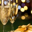 Glasses of champagne and present special occasion — Stok fotoğraf