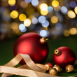 Stock Photo: Red Christmas baubles & gold jingle bells