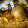 Gold christmas bauble and star decoration — Stock Photo