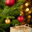 Christmas decoration tree, baubles and gifts — Stock Photo