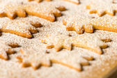 Baking christmas cookies comet star powdered sugar — Stock Photo