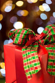 Traditional red christmas present with bow — Stock Photo
