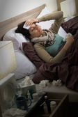 Sick woman with flu lying in bed — Stock Photo