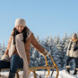 Young people enjoy sunny winter snow sledge — Stock Photo