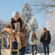 Sunny winter day people in snow countryside — Stock Photo