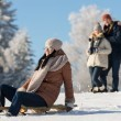Friends enjoy sunny winter day on sledge — Stok Fotoğraf #35239531