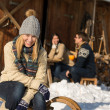 Young woman with friends snow winter cottage — Stock Photo