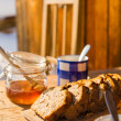Tea and fruit bread outside winter cottage — Stock Photo