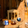 Tea and cake on wooden table cottage — Stock Photo #35239753