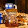 Tea, honey and fruit bread on wooden table — ストック写真