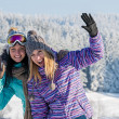 Two female friends winter snow in mountains — Stock Photo