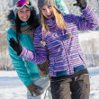 Two girlfriends in winter snow mountains smiling — Stock Photo