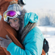 Young couple ski goggles embrace winter snow — Stock Photo