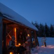 Sunset winter cottage friends enjoying evening — Stockfoto #35239907