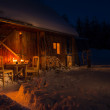 Cozy wooden cottage in dark winter forest — Stock Photo