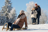Friends enjoy sunny winter day on sledge — Stock Photo