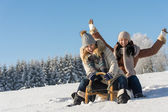 Two girlfriends sledge downhill in wintertime — Stock Photo