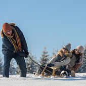 Friends having fun on sledge sunny winter — Stock Photo