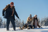Young people enjoy sunny winter day sledge — Stock Photo