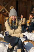 Young woman sitting winter snow sledge cottage — Stock Photo