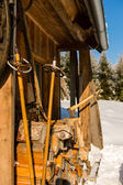 Snow winter cottage from outside ski poles — Stock Photo